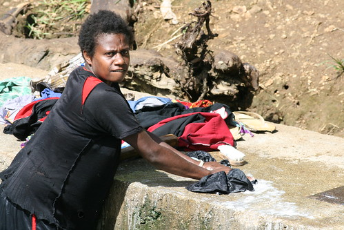 Woman doing laundry in local river vanuatu a woman for Chapman laundry