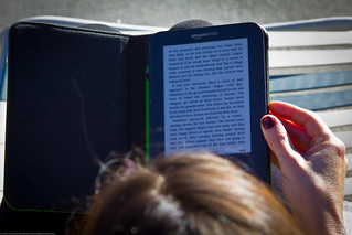 Women Reading Kindle Outside | by Dave Dugdale