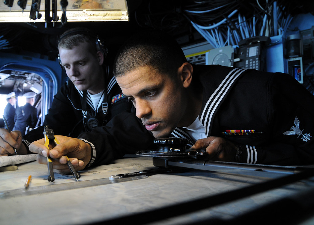 by official us navy imagery navy quartermaster checks navigation chart aboard uss essex by official us navy imagery