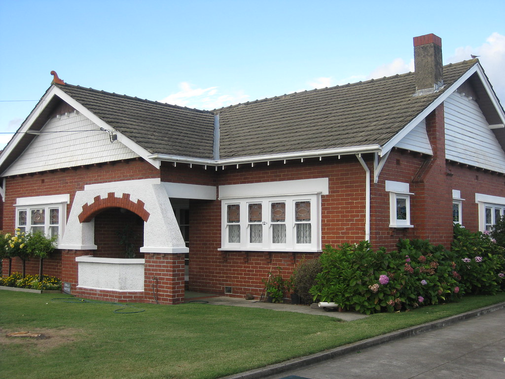 A Large Red Brick Arts And Crafts Style Bungalow