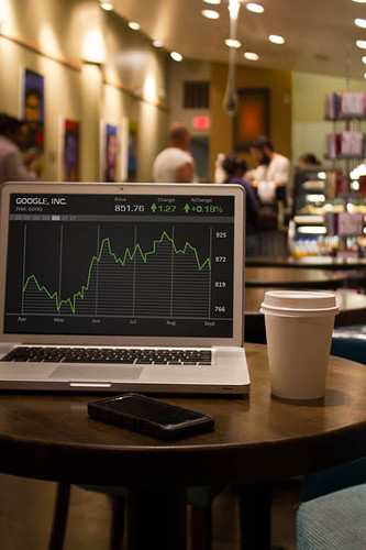 Graph on computer in Coffee Shop | by ota_photos
