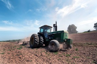 A tractor turning the cover crop into the soil | by USDAgov