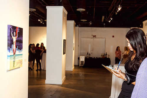 Judges selecting winners at Jordan Winery's 4 on 4 Miami Art Competition exhibition at Bakehouse Art Complex | by 4on4Art