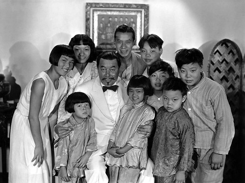 Charlie Chan (Warner Oland) with some of his children in a publicity still from 20th Century Fox