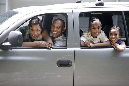 Family in Their SUV --- Image by © Royalty-Free/Corbis | by Pavon Insurance Agency - Allstate Insurance