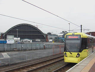 Manchester Metrolink tram at Deansgate Castlefield tram stop, with the long-closed Manchester Central station behind