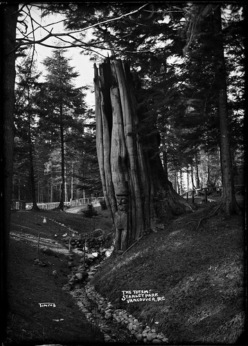 Totem figure by a tree in Stanley Park. VPL7289 | by Vancouver Public Library Historical Photographs