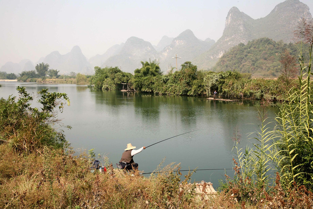 Image result for fishing on river bank