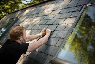 Tyler Inserting Slate into Gap Where Roofing Jack Used to Be | by goingslowly