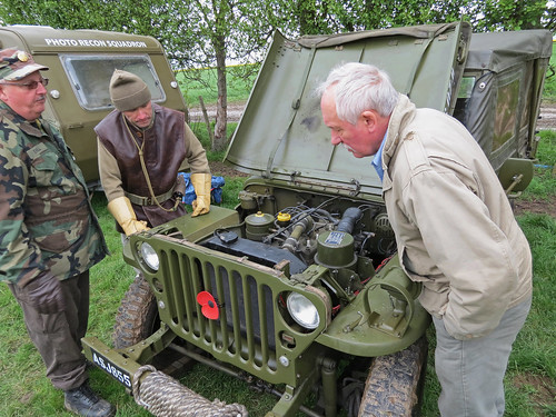 Ian and friends inspect a Jeeps Engine | by Beer Dave