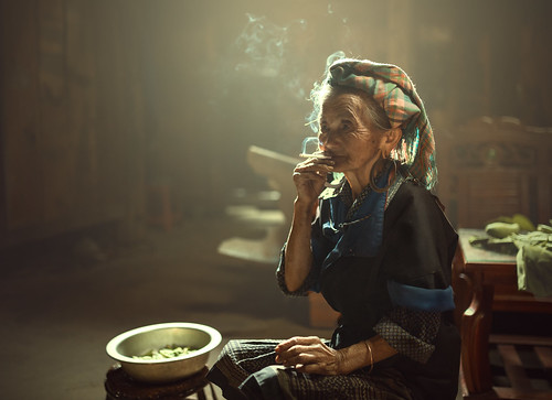 Alone woman smoking time