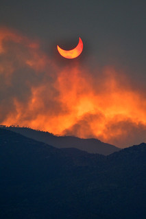 Annular eclipse seen through smoke from the Arizona wild fires | by lissagwen