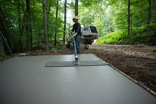 Tyler Using Bull Float to Smooth Concrete | by goingslowly