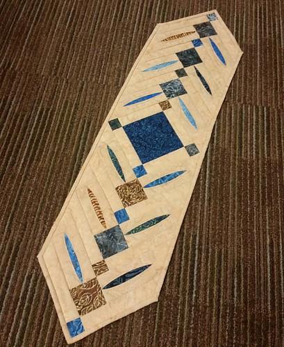 Peek a Boo table runner made from blue batiks.