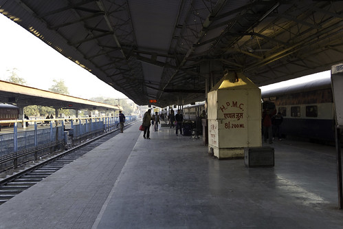 Food And Drink Stalls And Passengers On A Platform In The