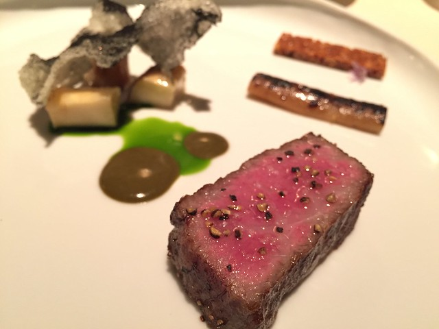 "A5 Wagyu grilled beef ""au poivre"", burdock, and matsutake"