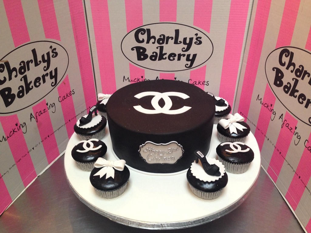 Simple Elegant Chanel Themed Birthday Cake Covered In Black Fondant Icing With Flat White