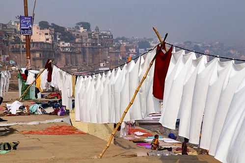 Life, death, and laundry. You see it all on the Ganges riverfront in Varanasi, India. #travel #india @onthegotours | by JonathanLook