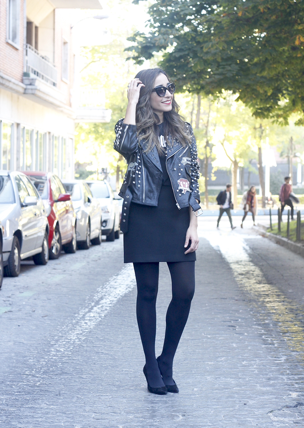 Leather jacket with studs and patches black skirt heels style fashion outfit02