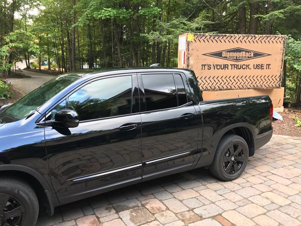 ... A DiamondBack Truck Bed Cover Ready To Be Installed On A Honda Ridgeline  | By DiamondBack