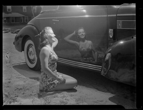 Girl admires reflection in shiny new car | by Boston Public Library