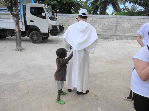 Youri tries to steal my priestly stole. | by Province of Saint Joseph