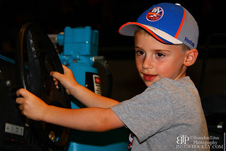 A New York Islanders fan poses for a photo on the Zamboni | by insidehockey