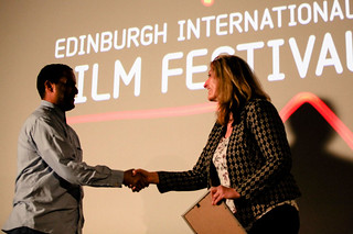 Director Mahdi Fleifel receiving the Award for Best Film In The International Competition from Siobhan Synnot for his film A World Not Ours | by Edinburgh International Film Festival