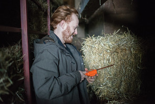 Tyler Checking Straw Bale Moisture | by goingslowly