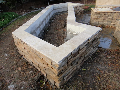 Cultured Stone Planter Box With Travertine Tile Cap In Dav