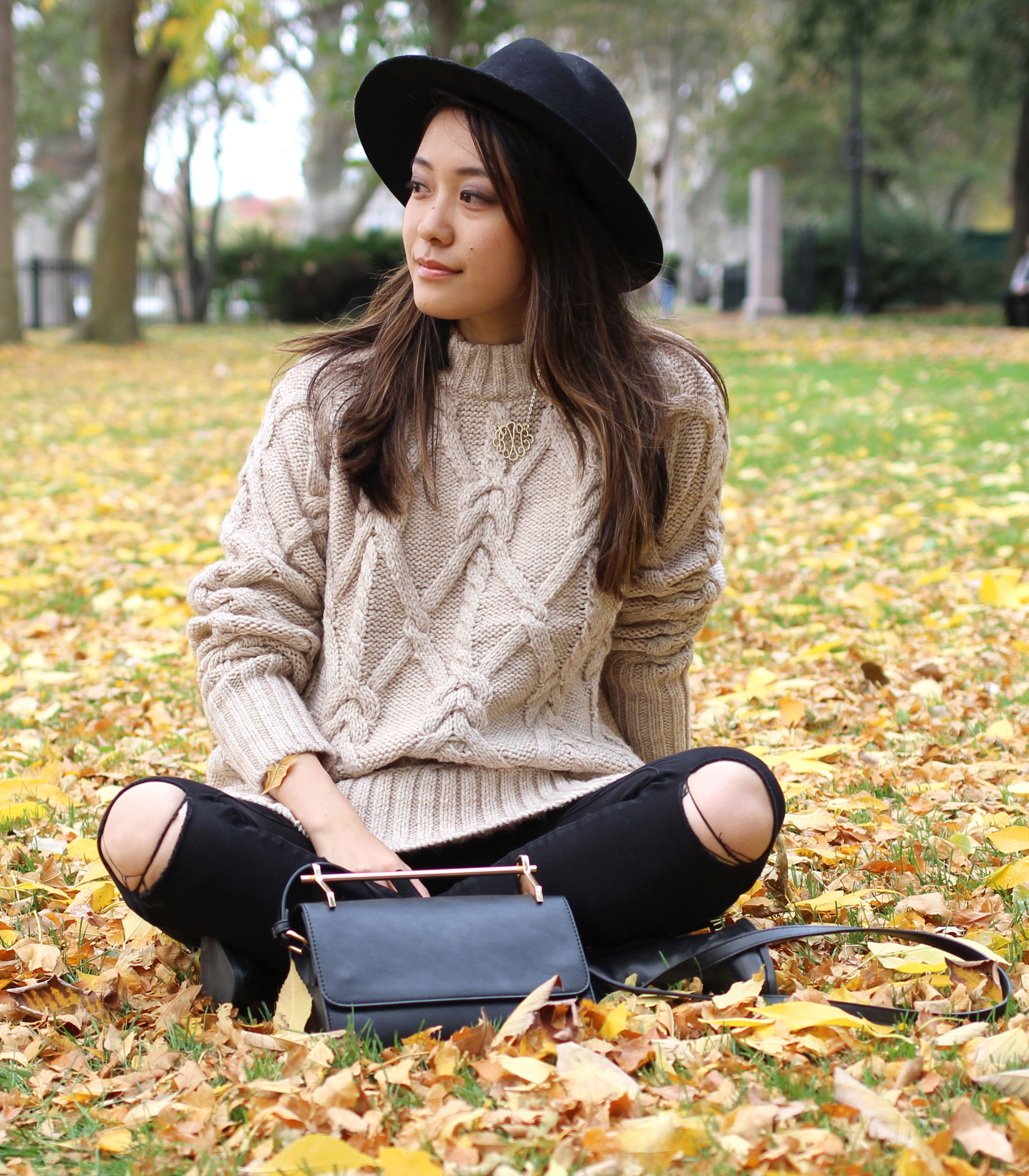 Taupe cableknit sweater and ripped hole jeans