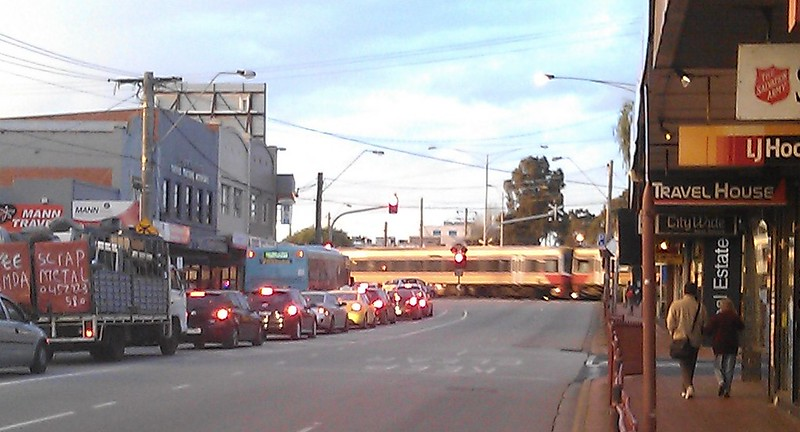 Not hard to see why pedestrians, cars, buses, ambulances get delayed in Clayton. Grade separation needed!