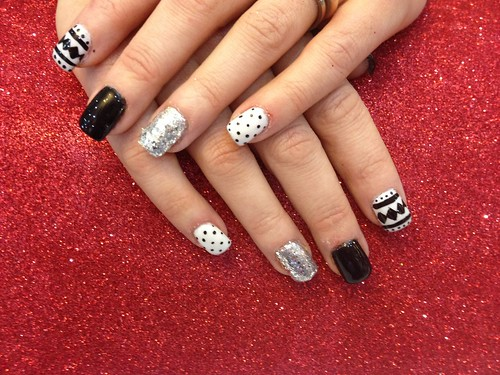Acrylic nails with black and white Xmas nail art | by Eye Candy Nails Nic Senior