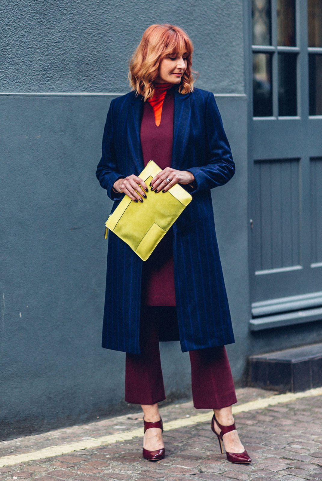 Bold jewel colours \ Autumn look \ fall outfit \ smart winter wear \ layering \ Jaeger \ Longline pinstripe coat, red roll neck, burgundy cocoon dress and cropped flares, yellow suede clutch | Not Dressed As Lamb, over 40 style