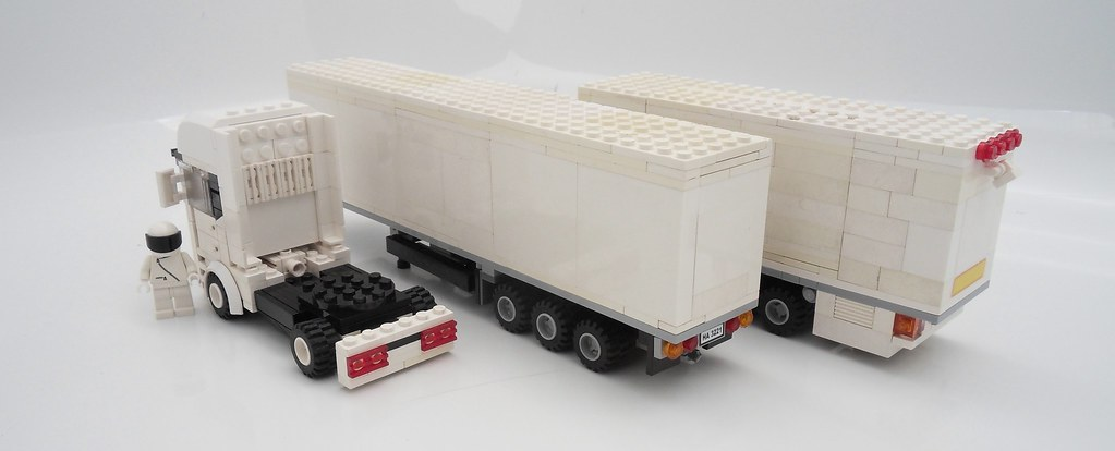 Coloring Trucks also 267229 further  furthermore 413346072032038220 likewise Img0069 popscreencdn   120941732 mack Granite Mp Dump Truck With Beavertail Trailer 150. on rc dump trucks with trailers