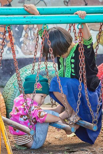 Hmong siblings playing