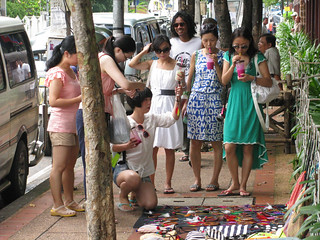Chinese tourist women looking at street wares
