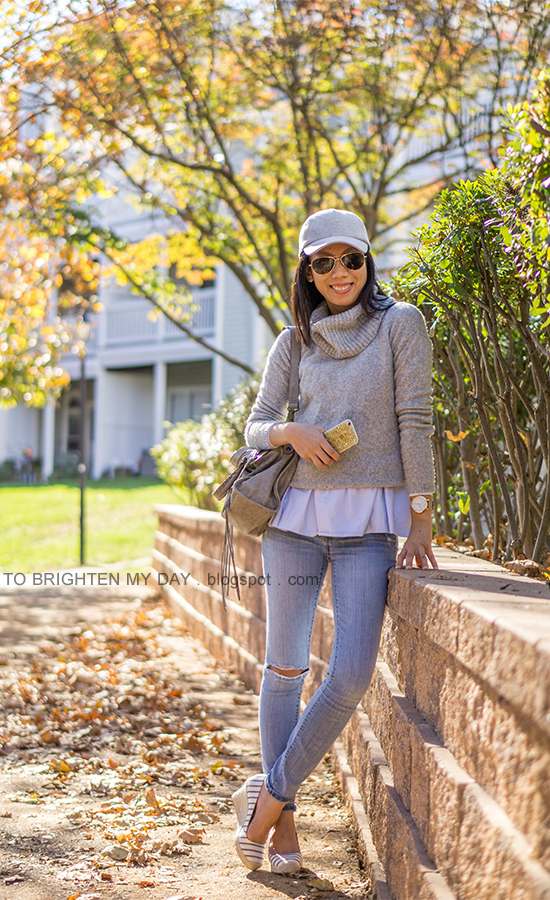 gray baseball cap, gray cowlneck sweater layered over baby blue peplum top, oversized watch, distressed lightwash skinny jeans, gray tote, striped espadrille wedges