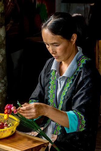 Hmong woman making flowers