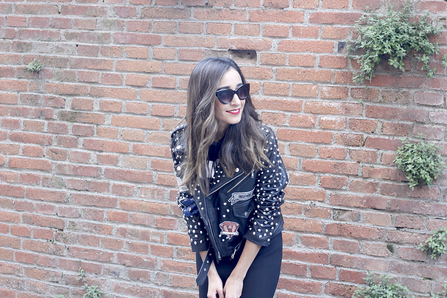 Leather jacket with studs and patches black skirt heels style fashion outfit15