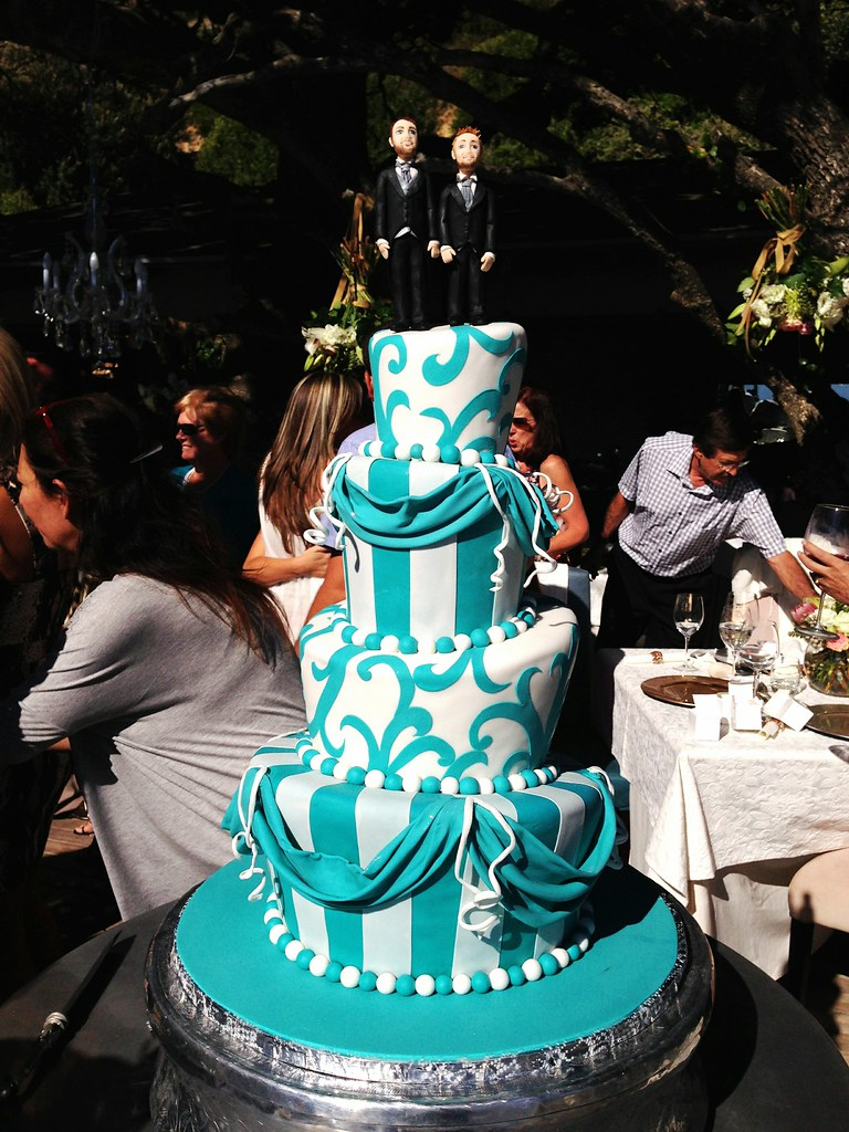 4-tier Mad Hatter style wedding cake in bright teal and wh… | Flickr