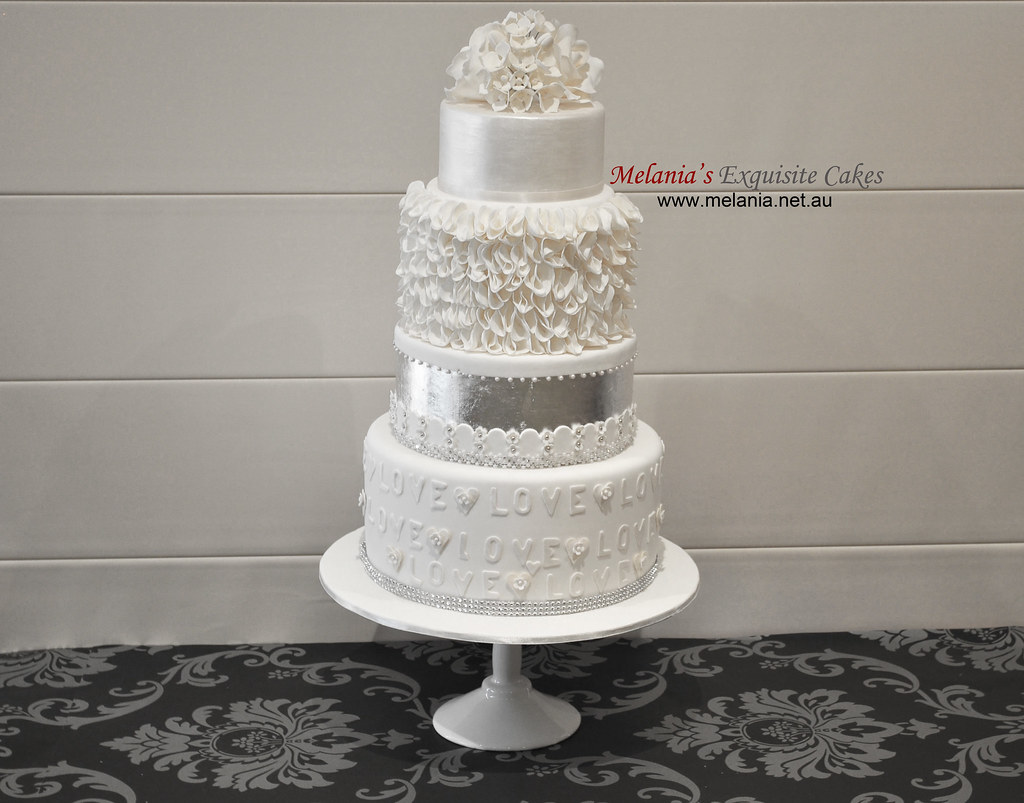 white wedding cake with silver leaf, lustre, ruffle and su… | Flickr