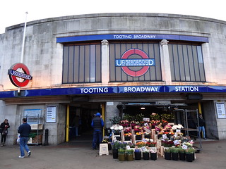47d - Tooting Broadway station entrance with flowers | by Randomly London