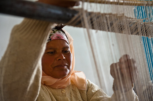 A woman in training center for production of local  handicrafts | by World Bank Photo Collection