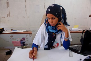 A student developing her drawing concept | by UNDP Sudan