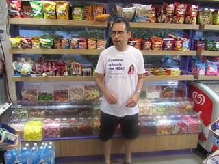 "Shlomi Fish wearing the ""Summer [Glau] schools the NSA"" shirt at a candy store 