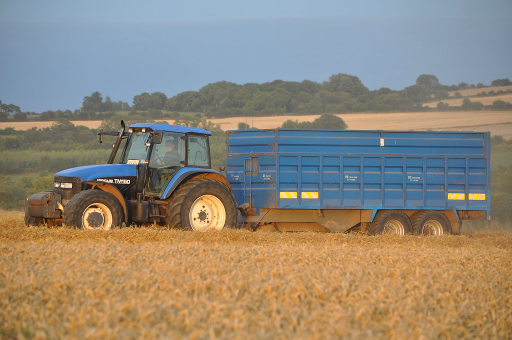 New Holland TM150 Tractor with a DC Trailer Grain Trailer