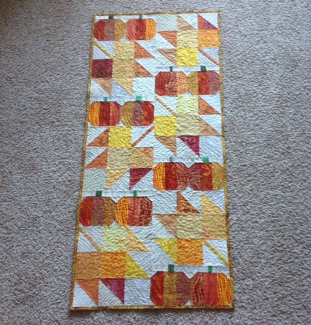 Autumn Jubilee table runner all quilted and bound.