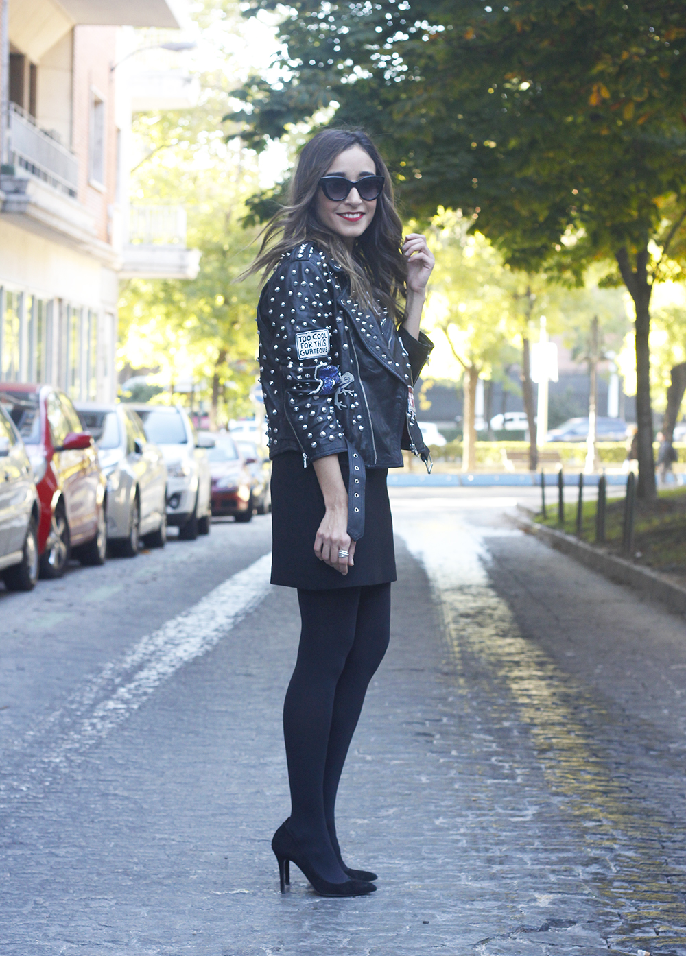 Leather jacket with studs and patches black skirt heels style fashion outfit05