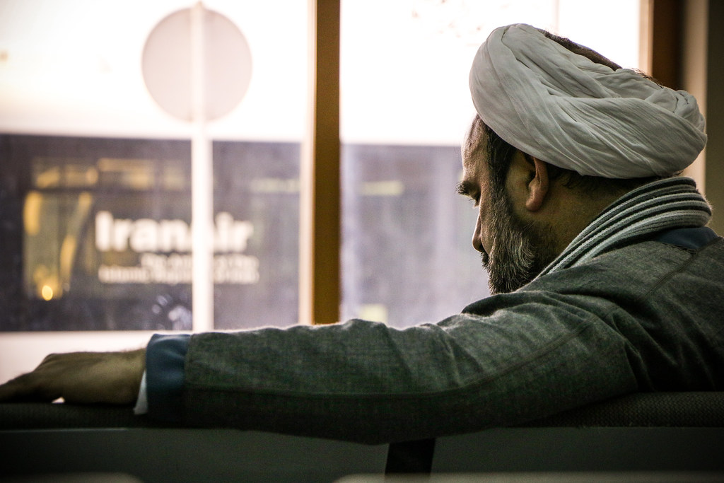 A man with a white turban in I...